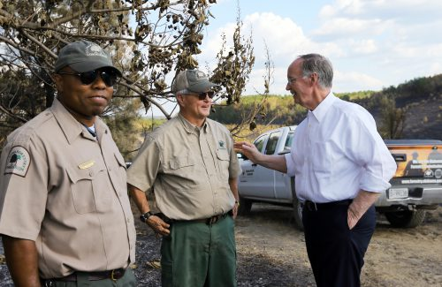"""Alabama Gov. Robert Bentley appeals to citizens about the serious drought situation in the state after touring the site of a recent wildfire in Walker County, near Dora, Ala., Thursday, Oct. 27, 2016. He joined Interim State Forester Gary Cole and Assistant State Forester Dan Jackson in urging residents to obey the Drought Emergency Declaration, often called a """"No Burn Order,"""" that he signed earlier this month. Since October 1, 2016, 987 wildfires have destroyed more than 10,730 acres in Alabama, more than four times the amount that occurred during the same time period in 2015. (Governor's Office, Jamie Martin)"""