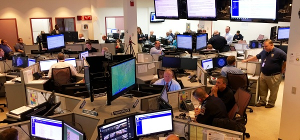 Emergency Management Coordinators from many state agencies work their stations at the State Emergency Operation Center